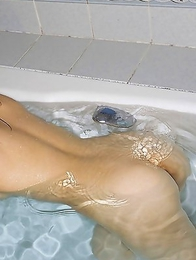 Rin Hitomi shows nasty ass and spoils fresh tits with water