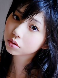 Beautiful gravure idol with milky white skin in silky lingerie